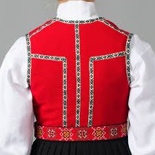 The Sunnhordland bunad has woven band round the vest and on the back. Vest colour is red, blue or green.