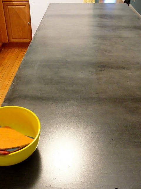 Has a tutorial and some pros and cons - DIY concrete counter tops... wanting to do a kitchen island and wondering about concrete top