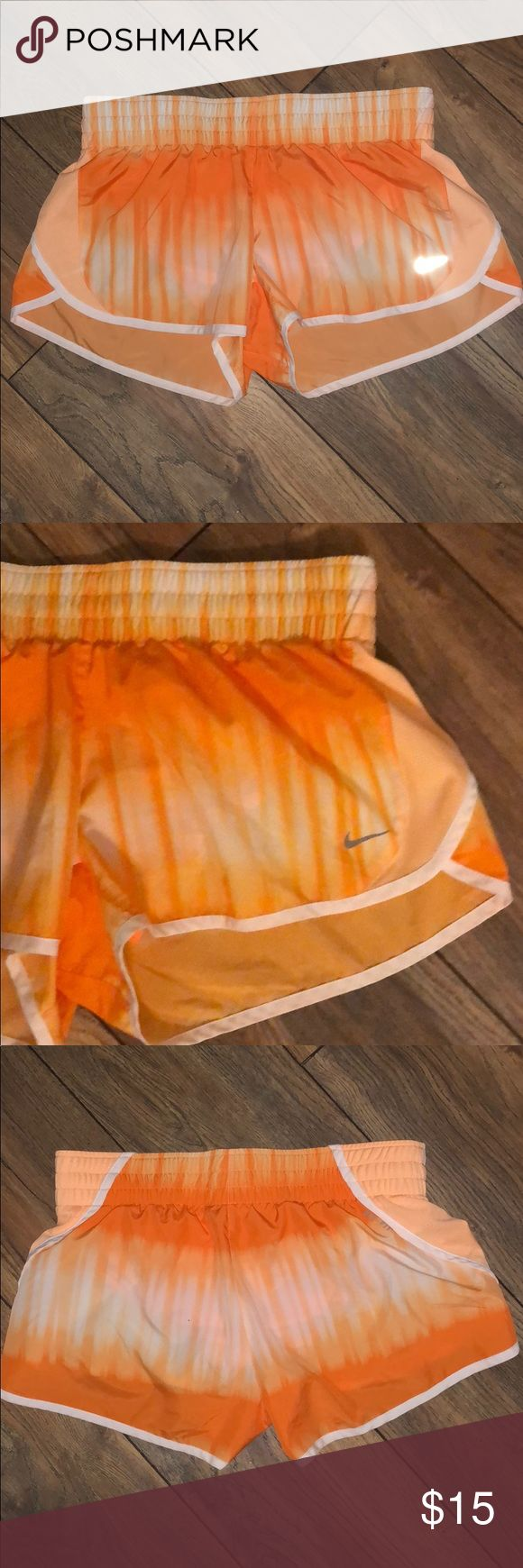 ✔️ Nike DriFit Shorts ✔️ Worn once and in excellent condition. Women's medium. Orange and white ombré shorts. Has inside liner and pocket. Thanks! Nike Shorts
