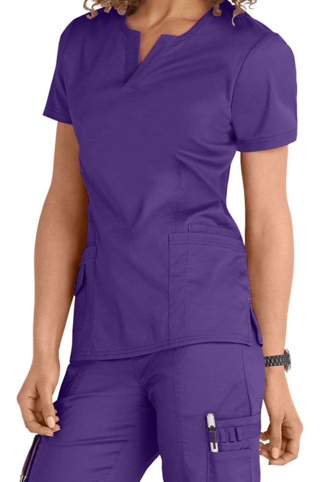 This stunning purple color is new for the season - and we love it in our Juna v-neck top! You'll love the four pockets for your accessories and the comfortable fabric.