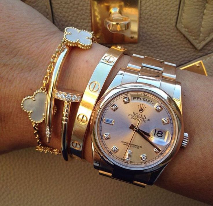 Arm stacking rolex watch with juste un clou love