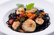 Sphagetti Cha Cha Cha - Ink spaghetti with tiger prawn and scallops stir-fried with Italian basil leaves, green peppercorns and chilies.