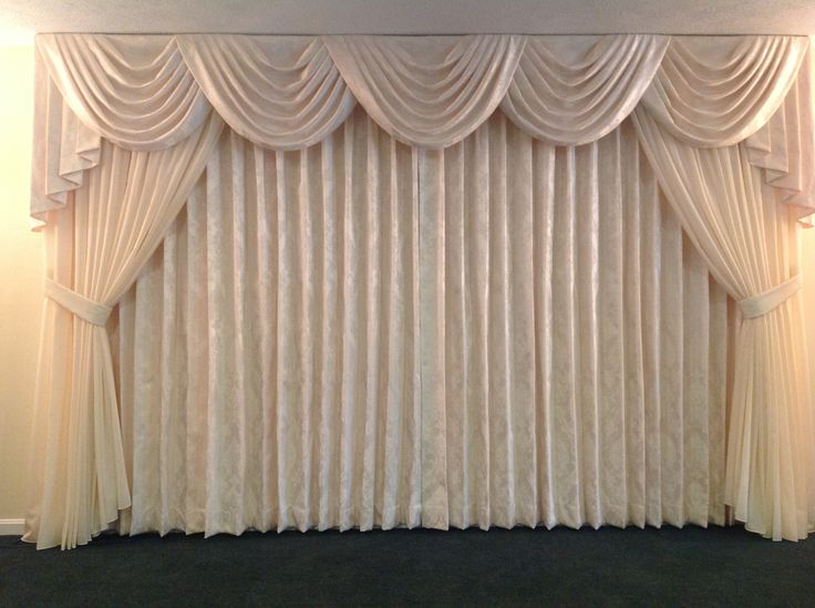 The finishing touches on the newly remodeled Yanac Funeral Home. Beautiful Custard Cream damask draperies and Swag and Jabot Valance with an Etherial sheer overlay and tie backs finish this soft elegant last repose.
