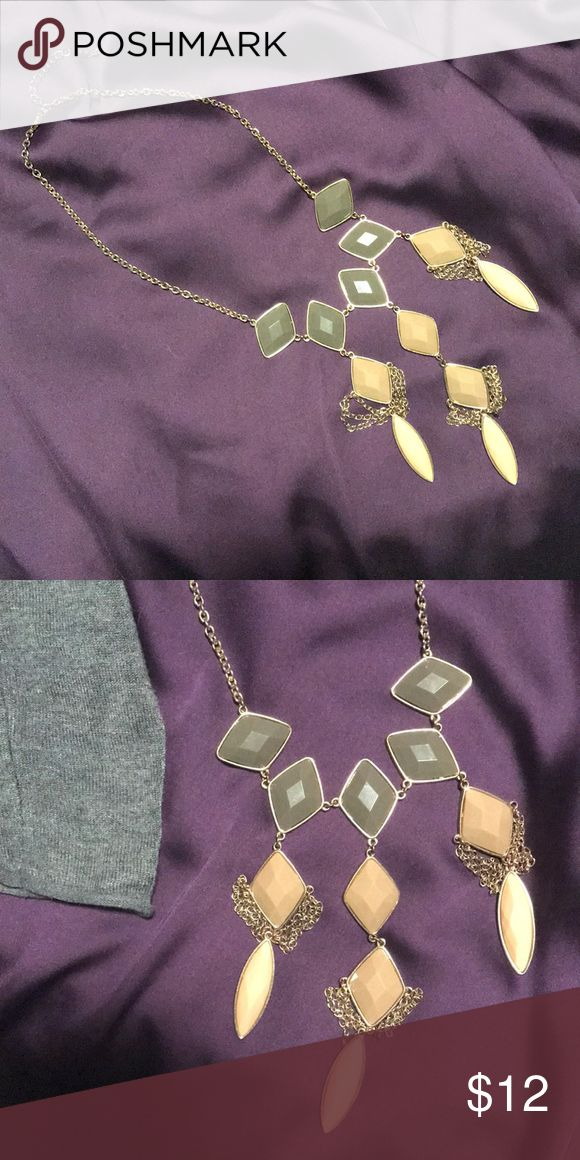 BKE statement necklace. (Grey, tans in color) Super cute statement necklace. Lighting kind of distorts the colors but the top is a gray color, middle is a Grey beige, and bottom colors are a peachy color, gold details. Super cute neutral necklace to dress up anything you throw on! BKE Jewelry Necklaces