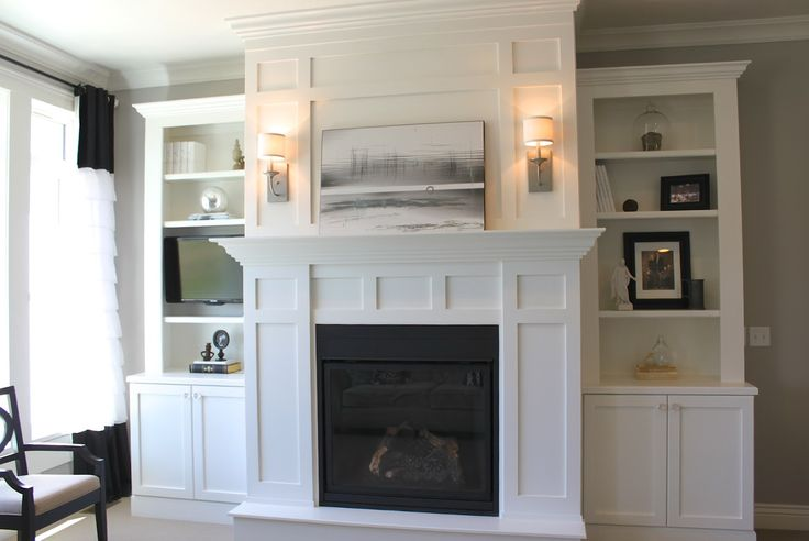 white built in cabinets around fireplace