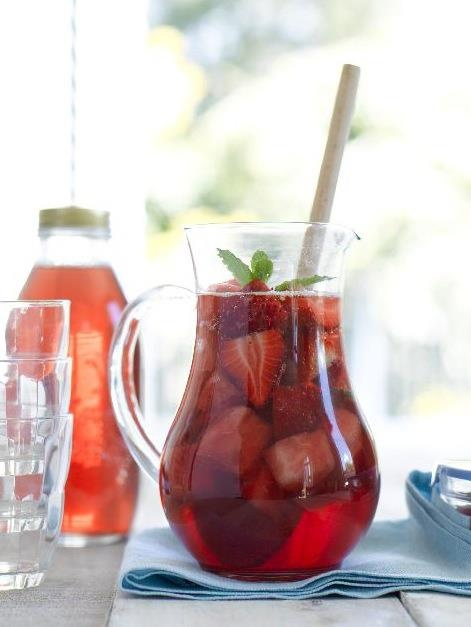 Julie Le Clerc's Strawberry Rose Sangria: 2 punnets strawberries, hulled and halved  A few mint leaves  60mls vodka  750ml bottle rosé wine, chilled  500ml bottle soda water, chilled  Combine strawberries and mint leaves in a large jug. Pour over vodka, wine and soda water, stir well and enjoy!  Serves 10