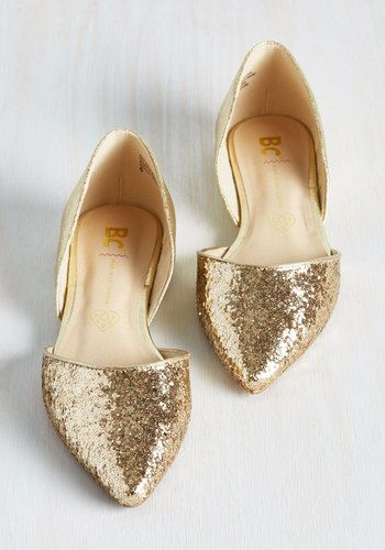 """Words like """"luxe"""" and """"lively"""" will ring through the air as onlookers take notice of these metallic gold flats by BC Footwear! Fantastically glittery at the pointed toe and starring sleek vegan faux leather at the heel, this d'Orsay pair is the great perfecter of exciting outings."""