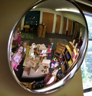 Domed Safety Mirror in block area..placed it above the building platform to give the children a different perspective to look at their creations, but it is also fun to look into and see the whole room and yourself. Art and Soul