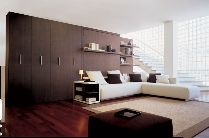 This is amazing space saving furniture, check out their website to see how the rooms transform