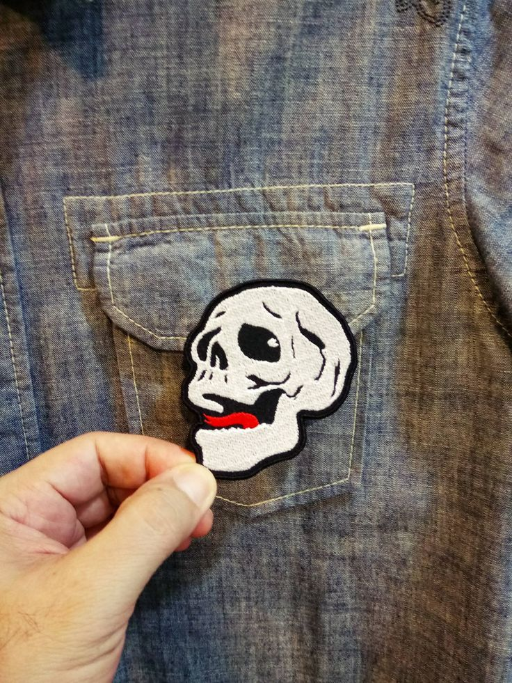 A Smiling Skull with a red tongue - Iron on patch by SundayNeek on Etsy
