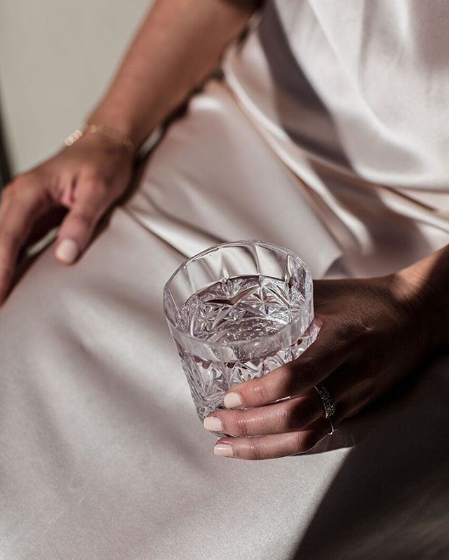 Welcoming the weekend in our Sara Champagne Silk Slip while sipping @cilkrosewater✨Shop online now (also available in navy or emerald) #natalijastyle | Photo: @anajst