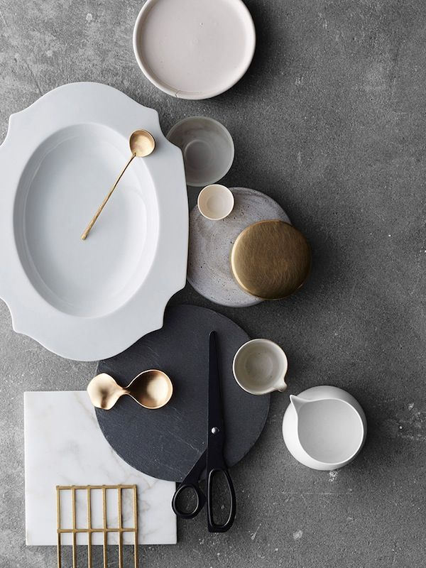 This color palette. Anchored in gray with shades of gray, white, black, maybe a hint of gold. No beige. Composition is really pretty. I like the use of negative space.