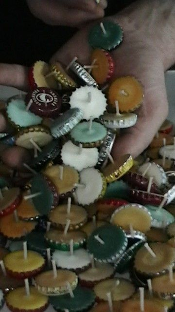Bottle cap candles. Easy to make. burn up to 2 hours. you can line them on the deck or use as a cool, smaller centerpiece.