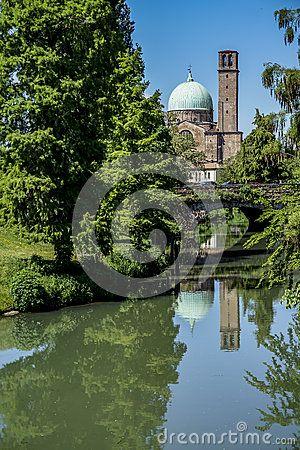 Padova view with Bacchiglione river - Parrocchia Santa Maria del Carmine and old bridge at the background, Italy