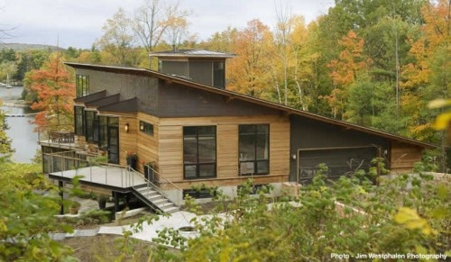 Shed roof. This is the simplest and most economical form of roof construction, in which the roof slopes down from one side of the house to the opposite side.    Adding interest: Exposed rafters add appeal to the shed roof on this waterfront home.