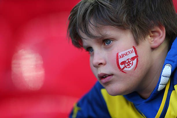 Young Arsenal soccer fan