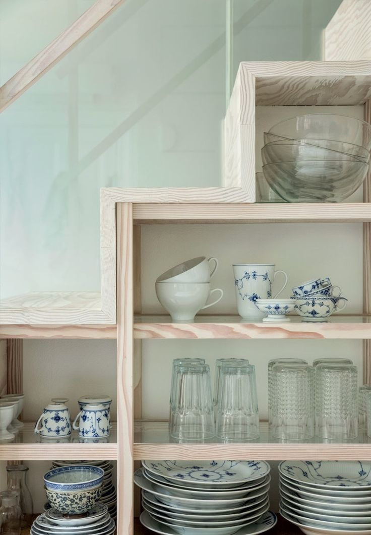 Organize your fine tableware and glasses in open shelves. It's a pretty decor idea in the dining room.