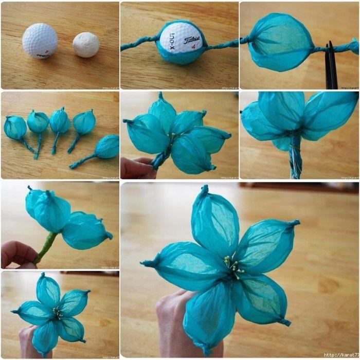 flores azules para hacer en casa muy sencillas ocn papel pinocho azul y pelotas de golf o pingpong.