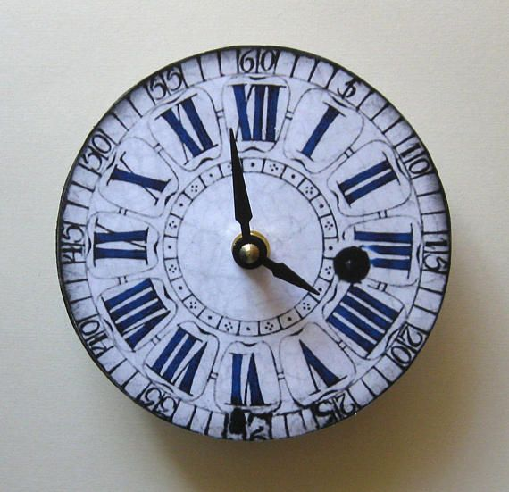 Small wall clock. Antique clock. Replica of antique clock.