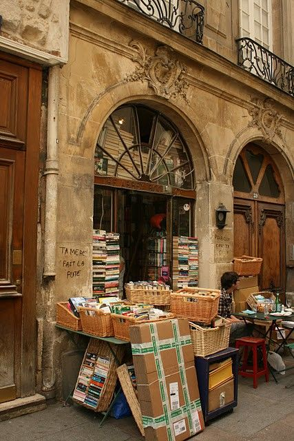 Abbey Book Store Paris, France  Darling, let's go in here and look at some books. What time do they close?  I could stay here all day.  How big is the trunk in the car.........