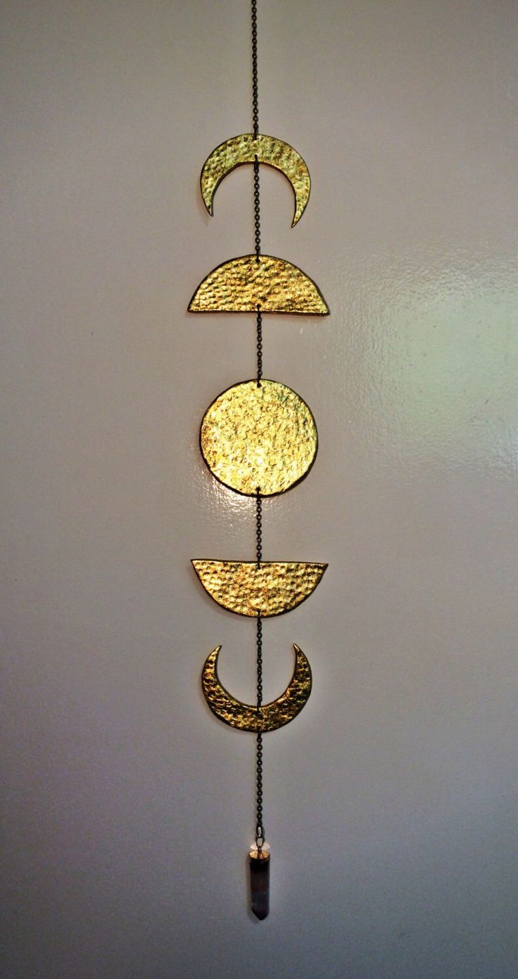 Lunar Moon phase Calendar wall hanging / sun catcher with wire wrapped crystal point drop.   A personal favorite from my Etsy shop https://www.etsy.com/au/listing/232109886/lunar-moon-phase-hanging-with-crystal