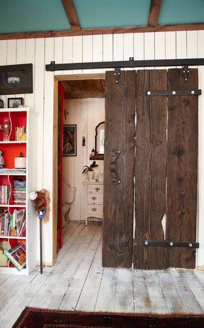 funky junkie western decor ideas... would love a barn door in my house someday…
