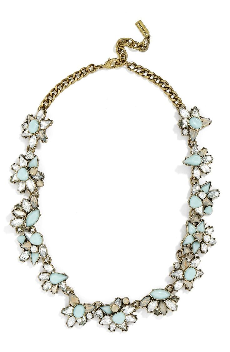 Antiqued links and mint-hued cabochons give this dainty collar necklace a hint of vintage appeal.