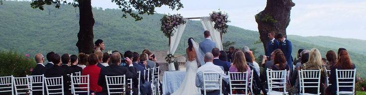Spring wedding in Chianti castle - outdoor ceremony with view. www.tuscantoursandweddings.com