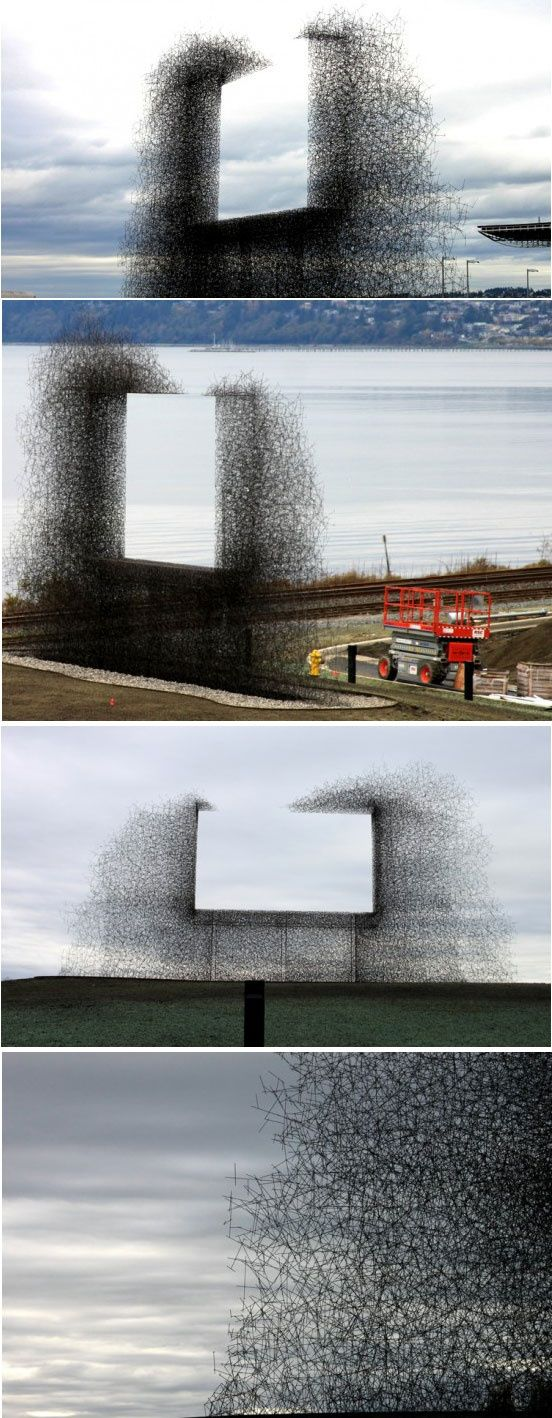 'non-sign II' is an installation by seattle based art collective lead pencil studio located at the Canada-US border near Vancouver. The sculpture is made from small stainless steel rods that are assembled together to create the negative space of a billboard.