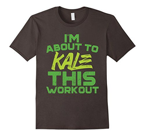 """I'm About To Kale This Workout Funny Vegan T-shirt Vegans are strong too! This vegan fitness design features the humorous food pun """"I'm About To Kale This Workout"""" for the vegan athlete! Perfect for the health food lover, foodie, vegan foodie, gym rat, vegan workout, and eater of a proud plant-based diet!"""