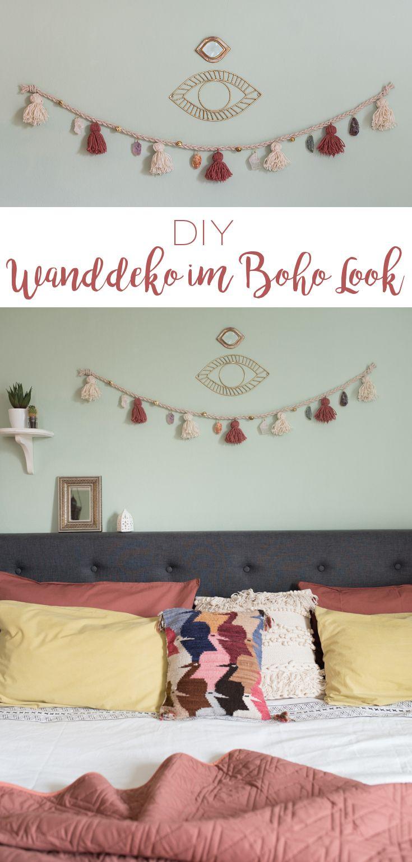 DIY - selbstgemachte Wanddeko Girlande im Boho Look mit Quasten aus Wolle und eingefassten Halbedelsteinen als Deko für das Schlafzimmer