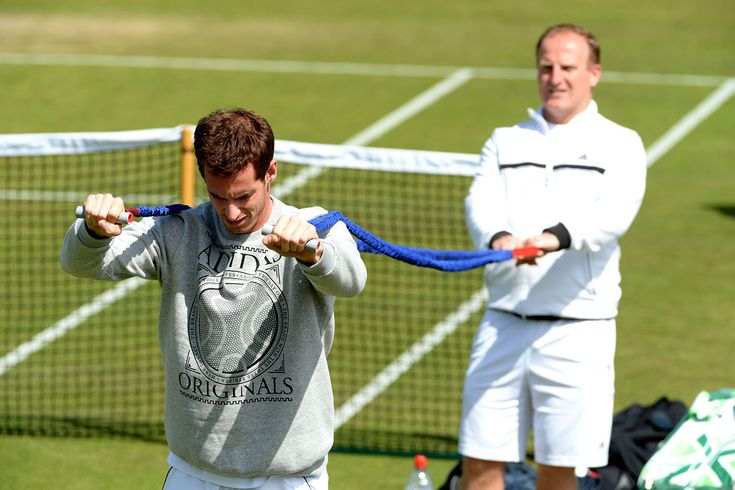 Practice week at Wimbledon 2014 - Day 2 Andy Murray gets some help with a stretch in practice