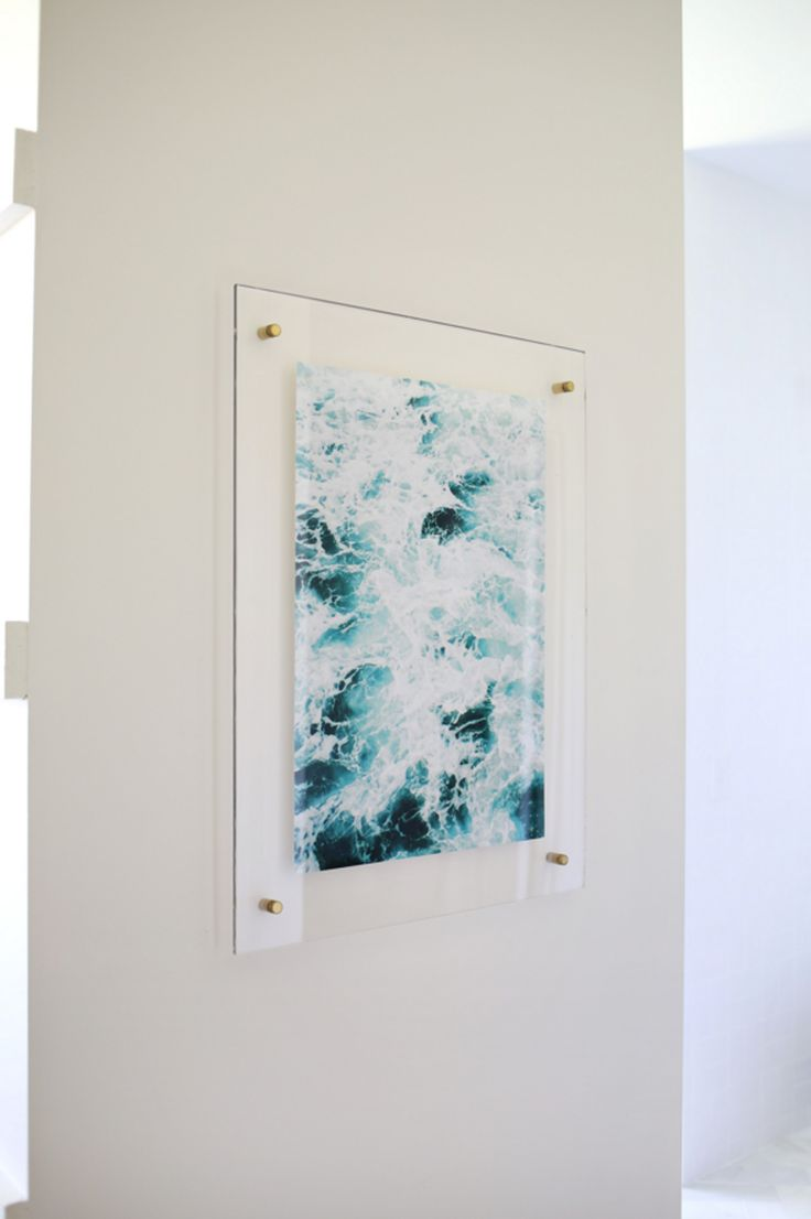Floating acrylic frame DIY from A Beautiful Mess. // 25 On-the-Cheap DIY Ideas to Make Your Living Room Look Expensive