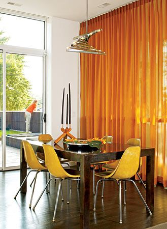 An Italian chrome chandelier marks the spot for the raw steel table in a Wicker Park dining room. Playing off yellow fiberglass shell chairs, the amber semi-sheer panels, which don't cover the entire span of the windows, can be shifted to follow the sun. Sliding doors open to a huge rooftop deck.Dining Rooms, Room Inspiration, Windows Covers, Eames Chairs, Semi Sh Panels, Parks Dining, Rooftops Decks, Entire Span, Sliding Doors