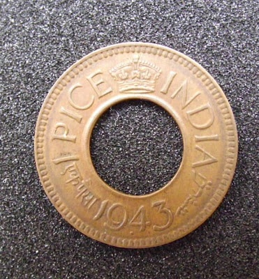 Indian 1-Pice coin with a hole in the center, 1943