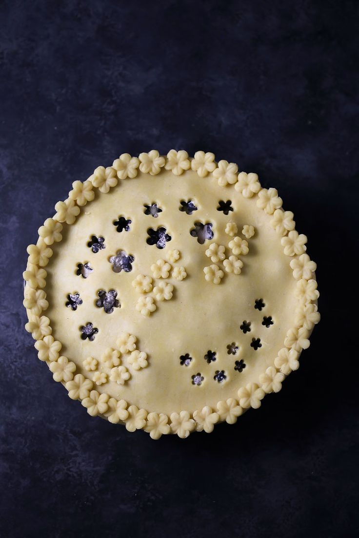 Happy Pi(e) Day! Let's get it going with a blueberry pie with a cornmeal crust. Simple, sweet and oh so celebratory!