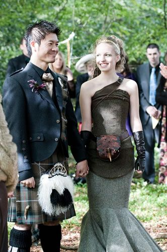 Tweed on the bride? Seriously? I guess it goes with the groom's kilt... I guess.