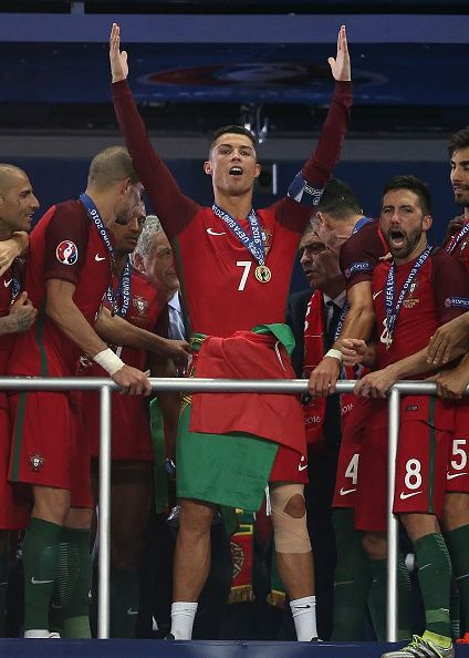 #EURO2016 Cristiano Ronaldo of Portugal celebrates before receiving the trophy…