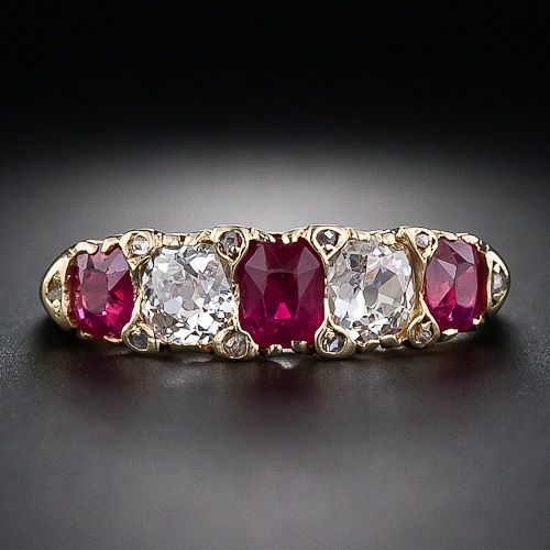 This classic, antique Victorian five-stone ring radiates with three gorgeous, intense-red, Burmese rubies separated by a pair of glistening, old mine-cut diamonds. And, if you look close, ten teeny-tiny, rose-cut diamonds are set at the corners of each gemstone. This enchanting antique ring is rendered in rich 18 karat yellow gold, and, unlike most of its more frilly counterparts, is crafted with clean, tailored lines. A beauty.