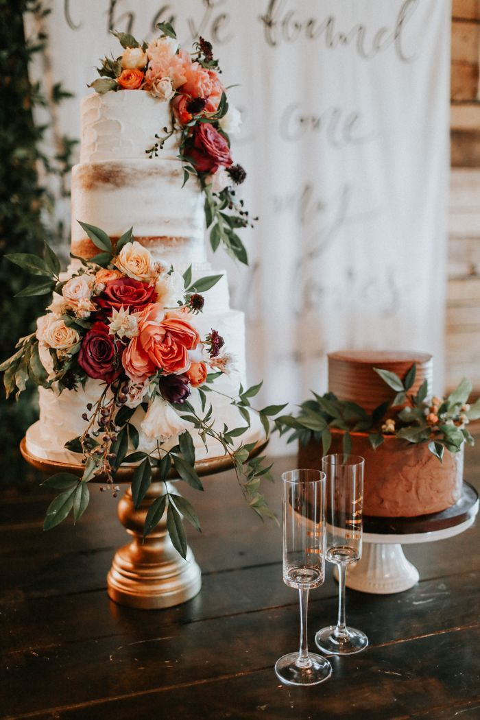 We love that this couple's bold + soft wedding theme carried over to their stunning flower-embellished wedding cakes | Image by Melissa Marshall