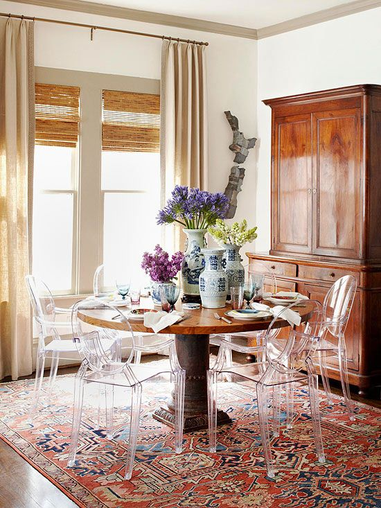 Dining Room by Meg Lonergan, Oriental rug + lucite chairs = perfect balance of old and new