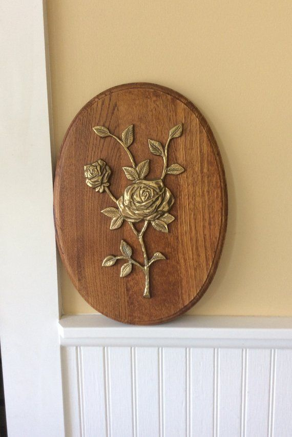 22d0bc8c0771 Vintage large oval wood plaque with brass rose. Small chain for hanging at  top back