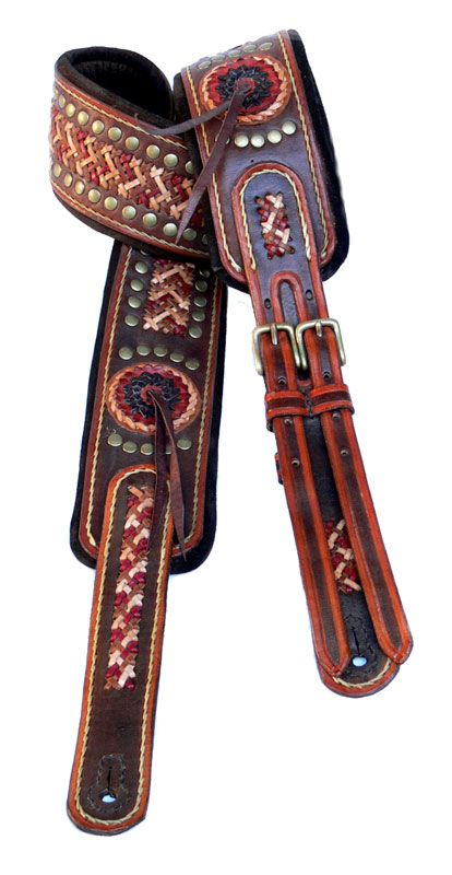 Leather guitar straps.. when I meet the right free spirited guy, he will love this. <3