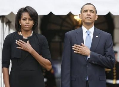 Netlore Archive: Emailed image appears to show Barack and Michelle Obama saluting the flag by placing their left hands (instead of their right) over their hearts.