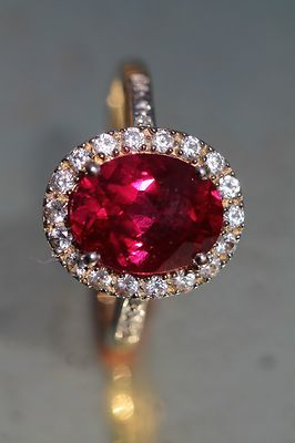 Ruby and diamond ring, but replace the ruby with a diamond to keep it traditional