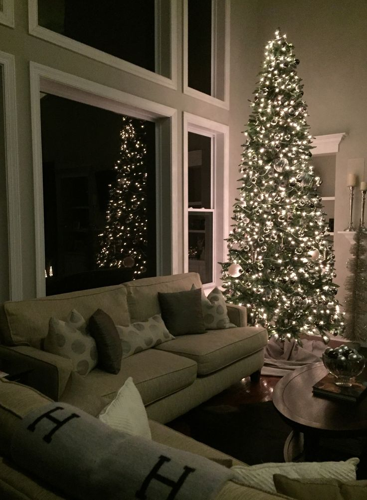 My silver, gray, gunmetal neutral 12 foot Christmas tree.