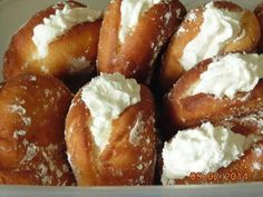 A homemade version of Dunkin' Donuts' popular yeast-raised, vanilla cream filled, deep-fried doughnuts. | CDKitchen.com