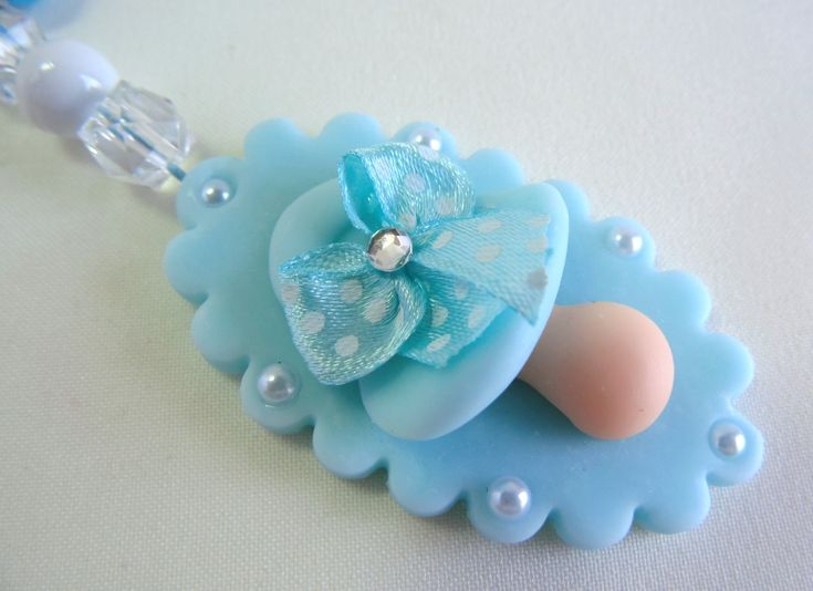 Cor: azul Material: biscuit e miçangas