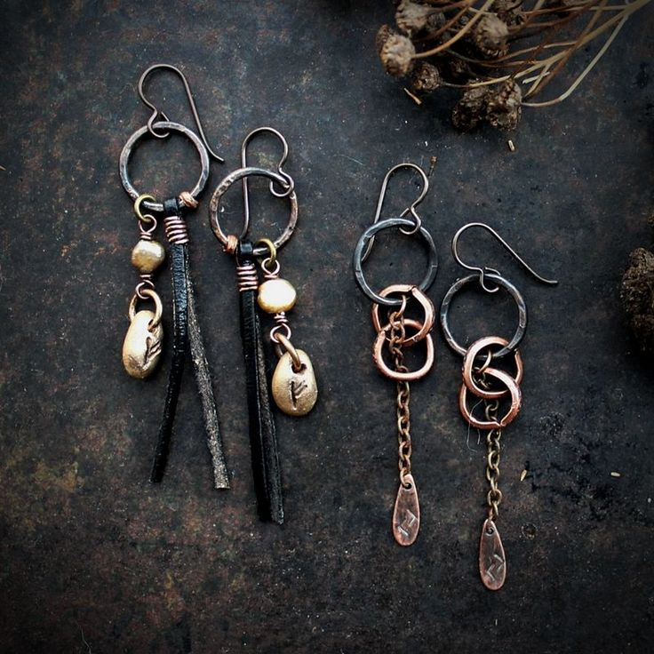Earrings with the runes Jera and Fehu. Jera is the rune of the fertile and harvest times. Fehu is the wealth and abundance those fertile times will bring us.