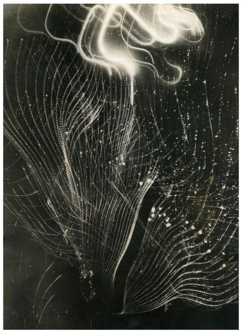 Europe enemy tracer bullets weave an intricate pattern as they shoot towards the planes of the royal air force during a night attack on Hamburg, December 23rd, 1943.